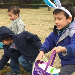 Three boys scamper for Easter eggs at the First Congregational Church of Stockbridge