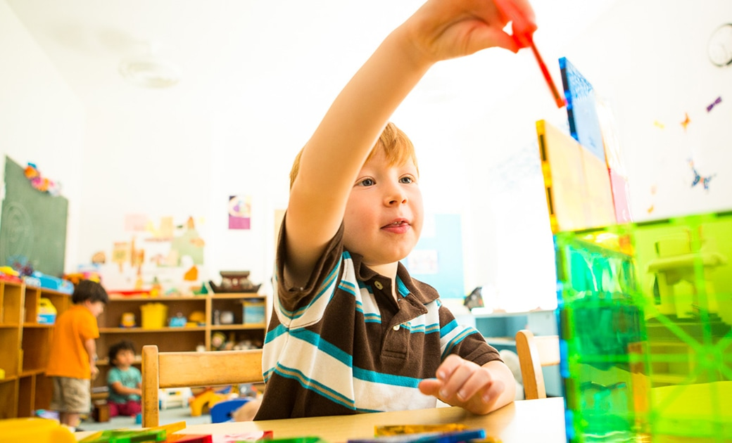 A boy plays with magnetiles in the nursery of the Stockbridge Congregational Church
