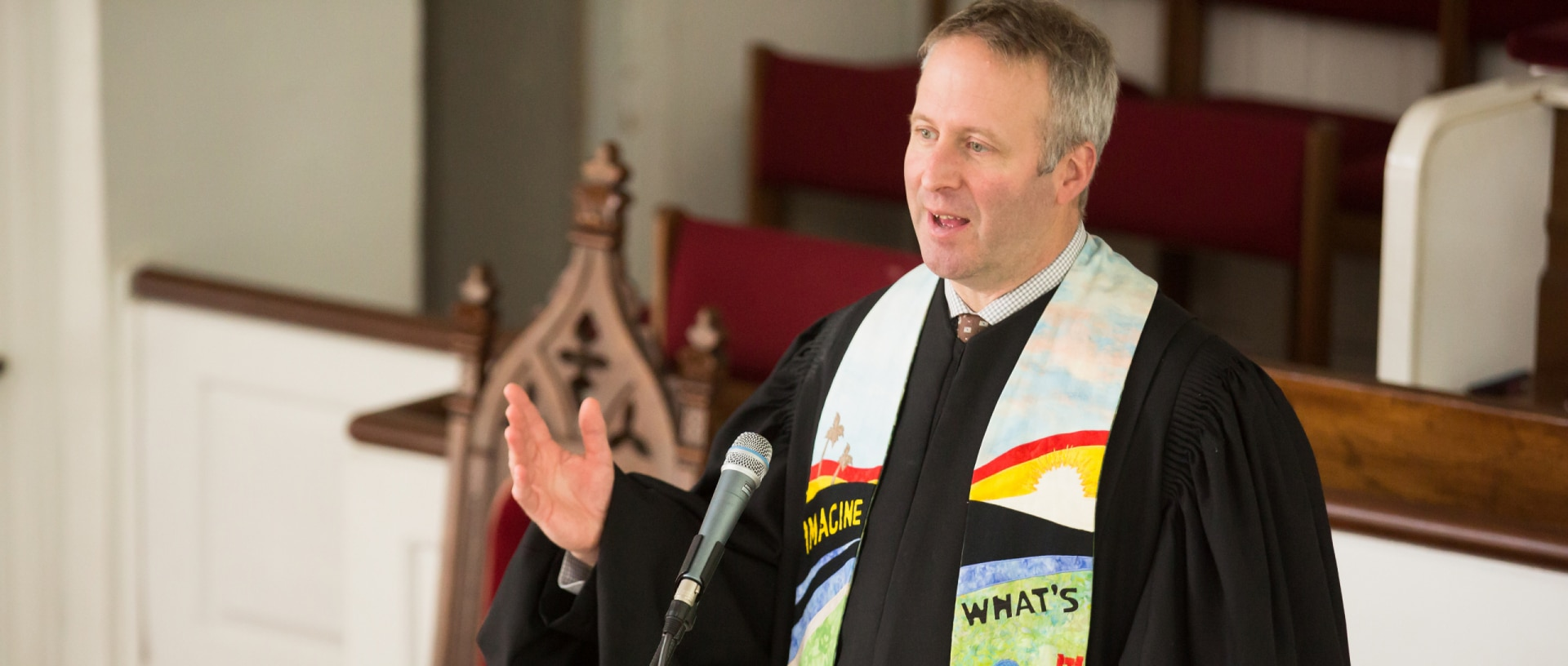 Rev. Brent Damrow preaches at the Stockbridge Congregational Church