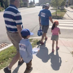 Two parents and their children walk on the First Congregational Church of Stockbridge's team.