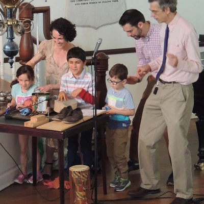 Kids and adults make homemade sound effects for the radio play
