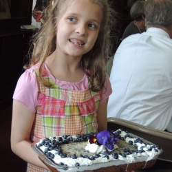 A girl carries a cake