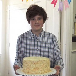 A boy shows off his cake