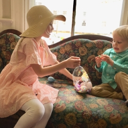 A brother and sister compare their Easter egg hunt treasures