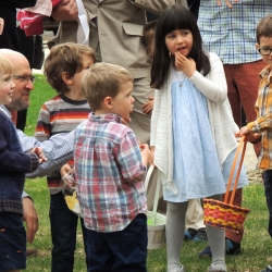 Children gather on the lawn after the concultion of the Easter egg hunt