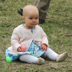 A baby rests on the lawn