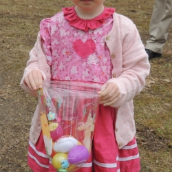 A tottler shows off the Easter eggs she has found