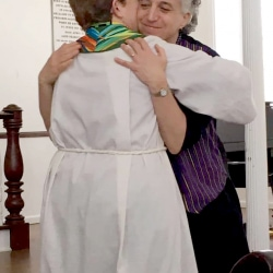 Rev. Patty Fox hugs a congregant