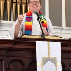 Rev. Patty Fox in the pulpit of the First Congregational Church of Stockbridge