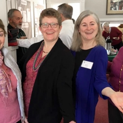 Rev. Patty Fox and three female congregants smile