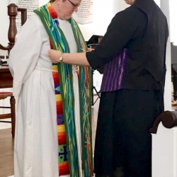 Rev. Patty Fox receives a clerical stole from a congregant