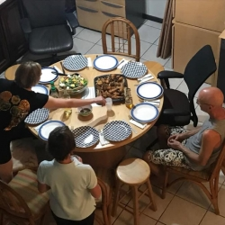 People gather around the dinner table