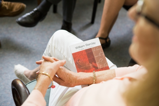 A woman holds a Bible in her lap