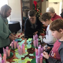 A group of women admires homemade Christmas ornaments