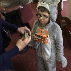 A boy dressed as a wolf