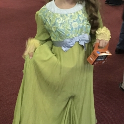 A girl dressed as a princess curtsies