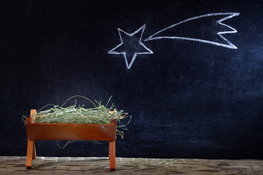A manger and star on blackboard.