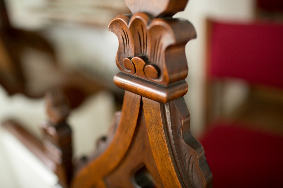 Detail of a carved wooden chair back from the chancel of the First Congregational Church of Stockbridge