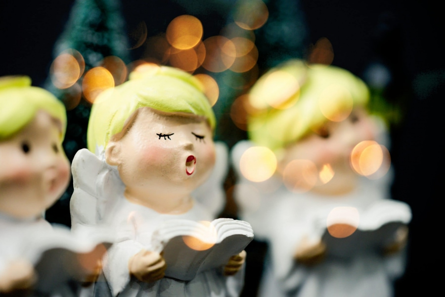A clay figurine sings Christmas carols