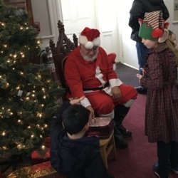 Santa Claus surrounded by children