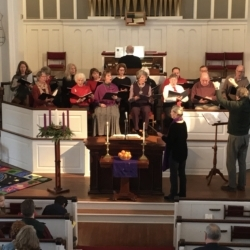 The choir sings during worship