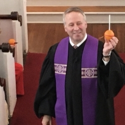 Pastor Brent shows off a completed Christingle