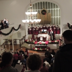 A full view of the sanctuary from the balcony, filled with people