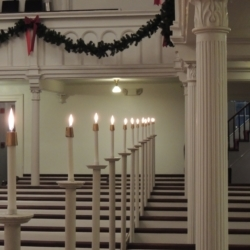 Candles illuminate the pews of the church