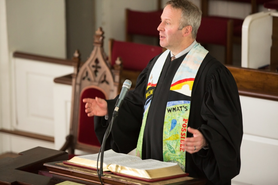 Pastor Brent Damrow preaches from the pulpit