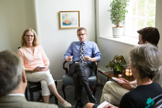 A group of people in a Bible study