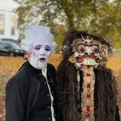 Two people dressed in creative masks